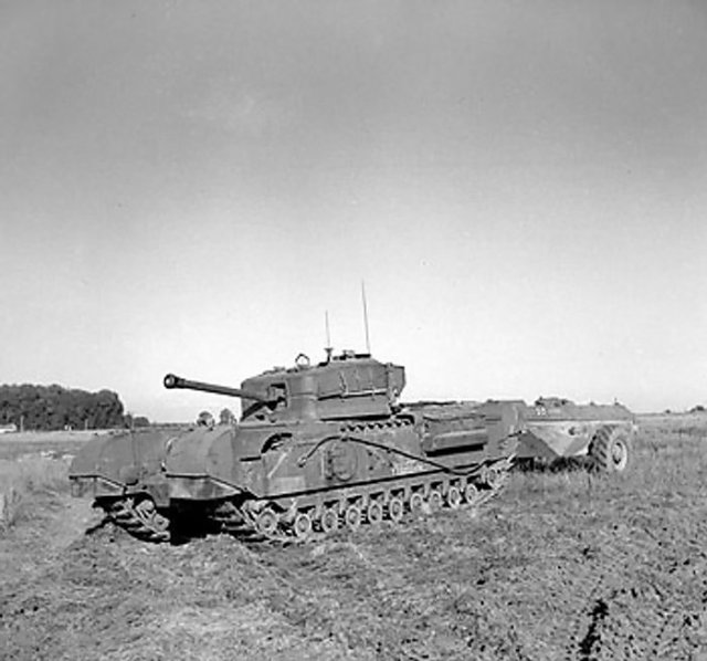 Churchill crocodile flamethrower tank at rest (1944)Churchill crocodile flamethrower tank at rest (1944)