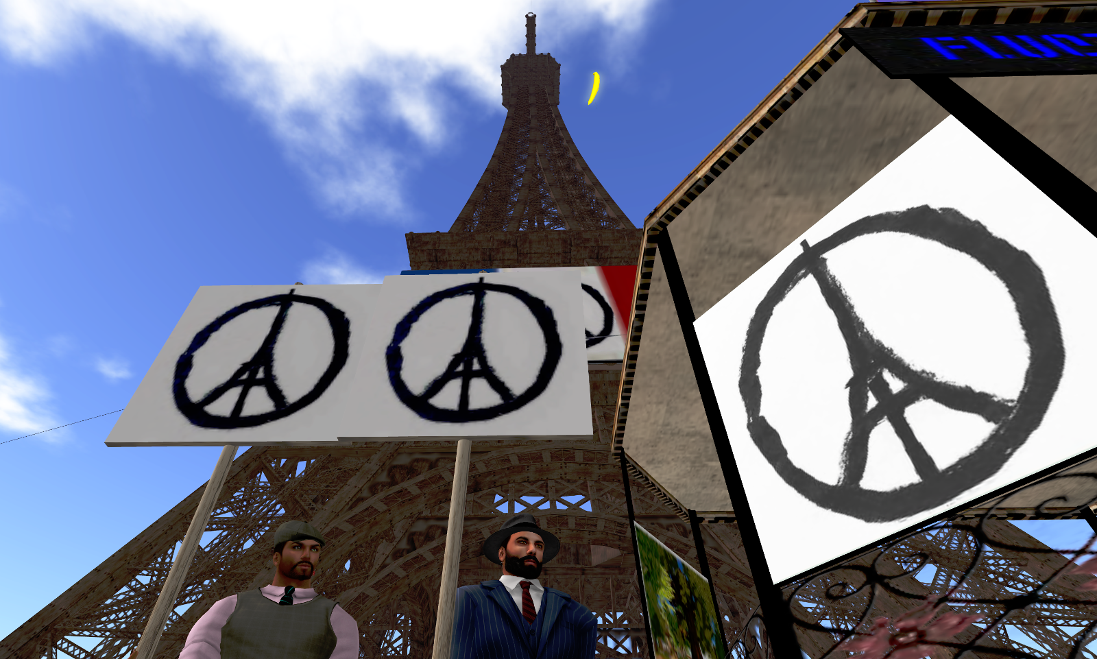 Randy and Ricco with the Peace for Paris sign at the Eiffel Tower