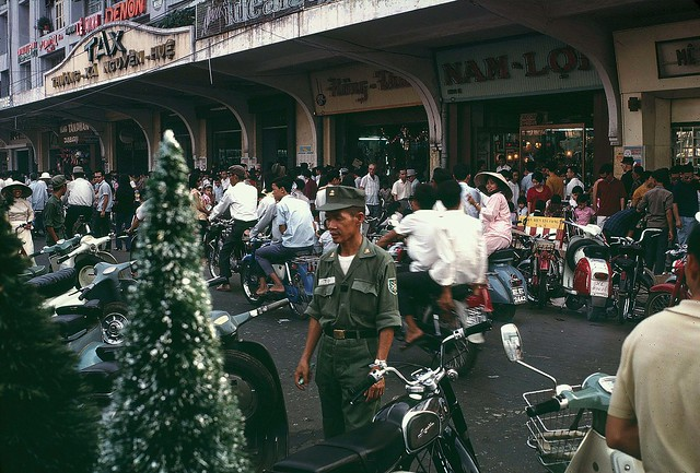 Saigon Street around Christmas 1968 - by William Ruzin
