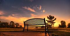 riverside bench at sunrise