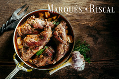 Roasted Rabbit Haunch in Pan on Rustic Wood Table