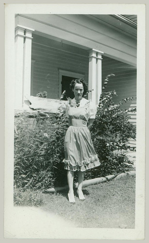 Woman at the side of the house