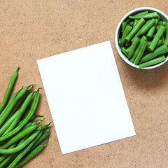 Sliced green beans  and a bunch of green beans in…