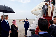 U.S. Secretary of State John Kerry waits at the bottom of the stairs as King Salman bin Abdulaziz of Saudi Arabia deplanes from his Boeing 747 after arriving at Andrews Air Force Base in Camp Springs, Maryland, on September 3, 2015, to visit President Barack Obama.  [State Department photo/ Public Domain]