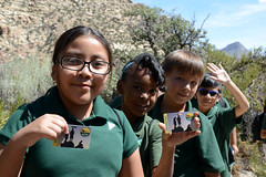 Students display their new Every Kid in a Park pass cards