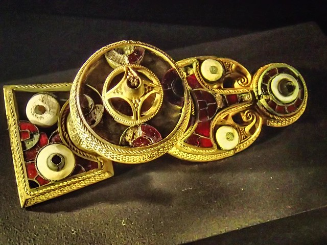 Viking Button-on-bow brooch interpreted as Freyja's brooch Brisingamen Grave Find Gotland Sweden 10th century CE (?) Bronze Gold and Garnet