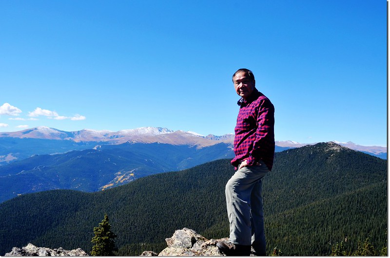 Me on the summit of Squaw Mountain, Mount Evans Area are in the background 3