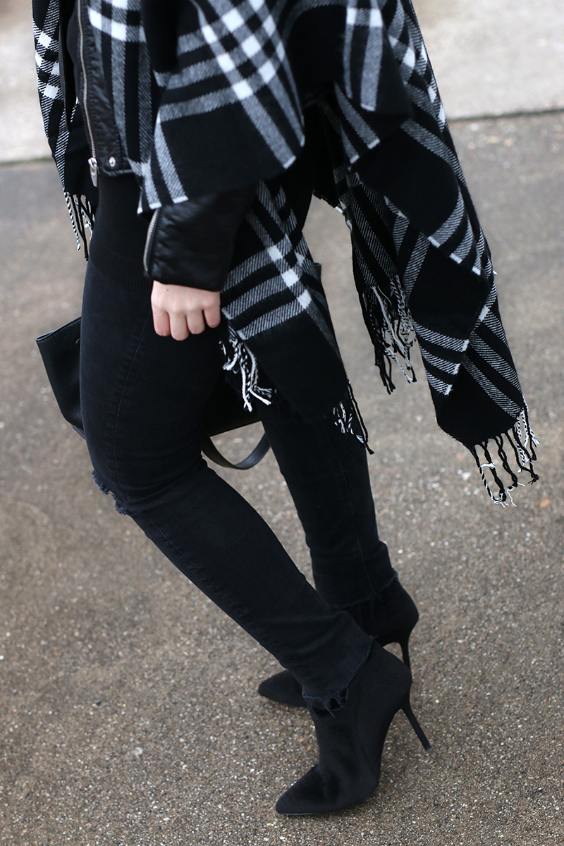 Black leather jacket and checked poncho with trapeze bag