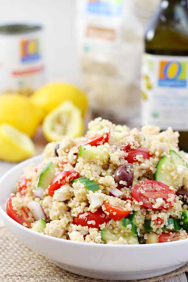 Mediterranean Quinoa Salad in a white bowl close up.