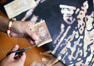 Myanmar artist cuts up banknotes