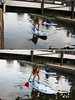 Ducking under the bridge on a SUP Board by Adrian Midgley