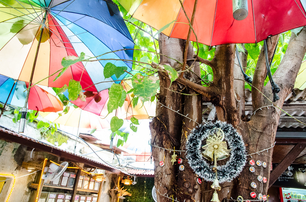 Colourful umbrellas inside Busy Bodhi Cafe