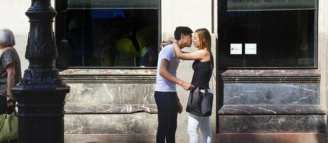 Young couple kissing; La Rambla, Barcelona (2015)