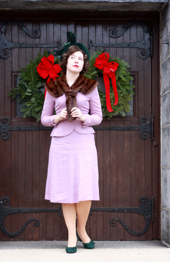 A winter vintage look with a green New York Creations hat, Miss L Fire Gabrielles in green from Royal Vintage Shoes, and a purple 1940s suit paired with a fur collar