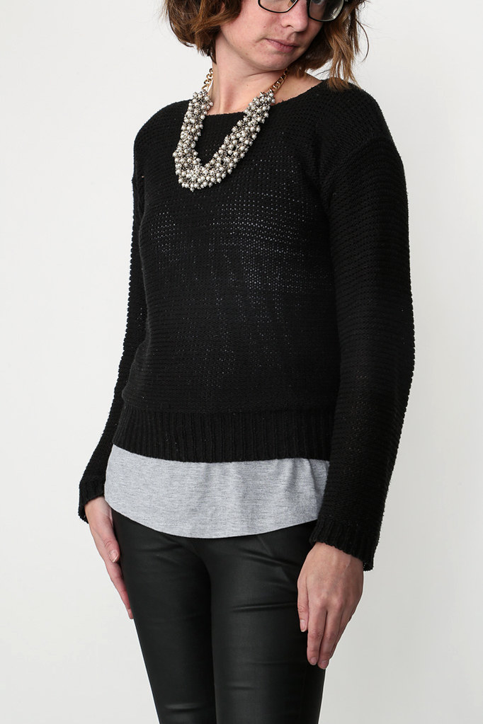 pearl necklace, black sweater, leather leggings
