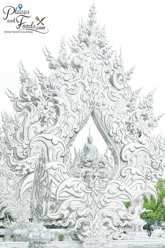 chiang rai white temple beautiful arch with buddha
