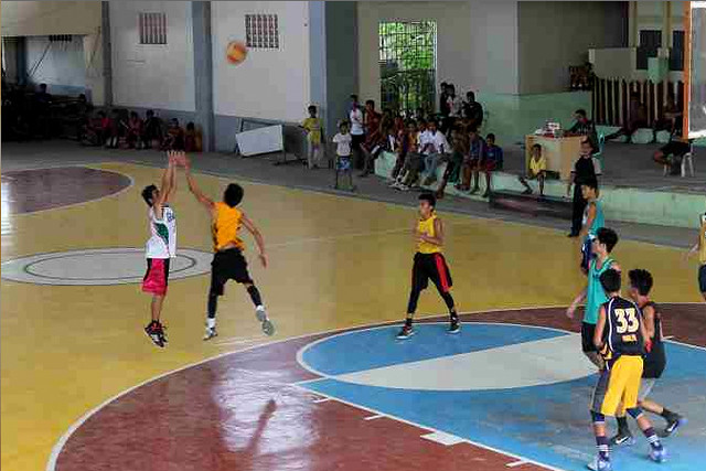 Basketball players in the newly-rehabilitated Capoocan Civic Center