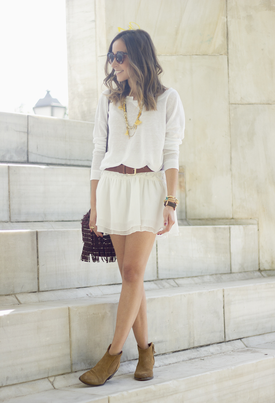 White casual outfit with brown booties and burgundy bag15