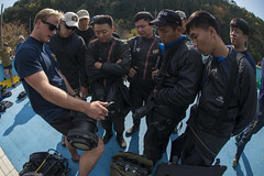 Explosive Ordnance Disposal (EOD) Technician 3rd Class Aaron Ainley, left, assigned to EOD Mobile Unit (EODMU) 5, explains the functions of the DNS-300 underwater sonar system to Republic of Korea Navy counterparts Nov. 5, in preparation for  exercise Clear Horizon 2015. (U.S. Navy/MC2 Daniel Rolston)