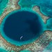 Aerial view of a boat in the Great Blue Hole