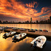 Cloudy Golden Sunrise over Boston Skyline and Charles River, MIT Sailing Pavilion with Dock from Cambridge Massachusetts USA by Greg DuBois Photography