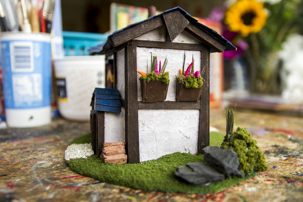 Model House: Side view with flower baskets
