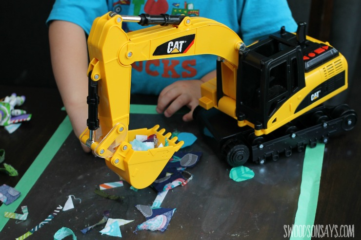 toy excavator with fabric scraps