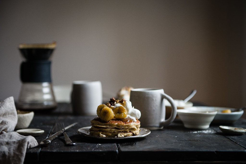 brown butter-oat pancakes with caramelized bananas & bourbon whip