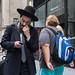 New York City Street Scenes - Man Checking His Phone by Steven Pisano
