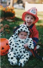 A Halloween fireman and his dalmatien