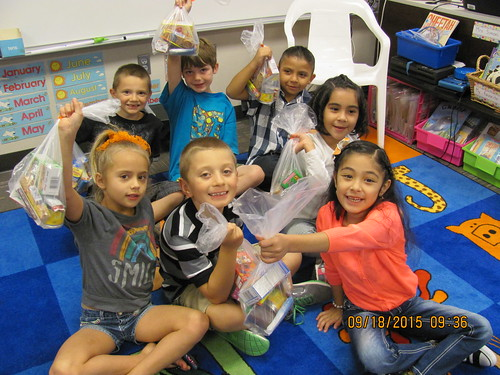 Students are excited to receive food bags to take home for the weekend.