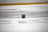 A Hershey Bears player's helmet lays on the ice after a fight by hartmantori