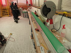 One 1 m long section of ice core and one 2 m long section of ice core matched up on the processing table before we cut the 2 m long section into two 1 m long sections