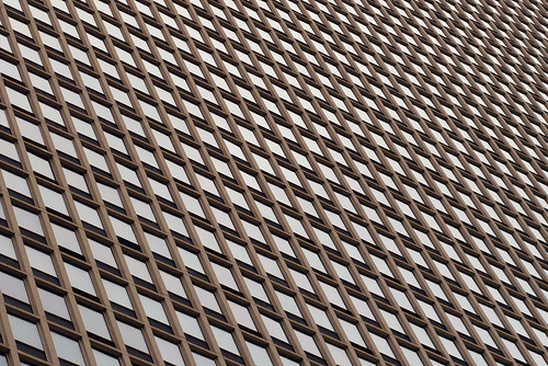 Geometric pattern formed by windows of an office block, Chicago, USA
