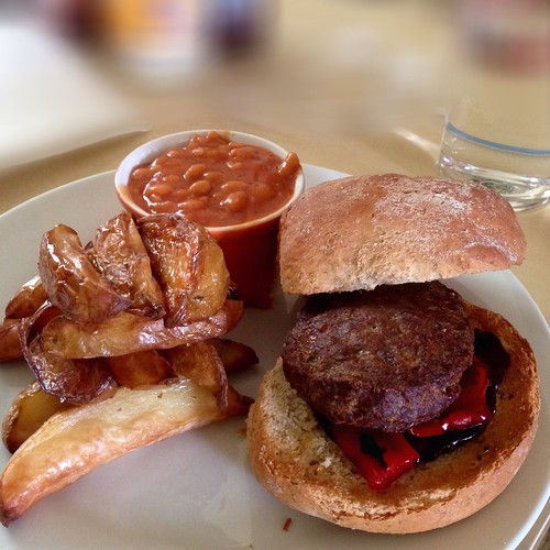 Burger! 😋🍔 Homemade bread roll, burger with griddled aubergine and red pepper, curried sautéed onions, homemade fat chips, and habanero chilli. 😋😋😋
