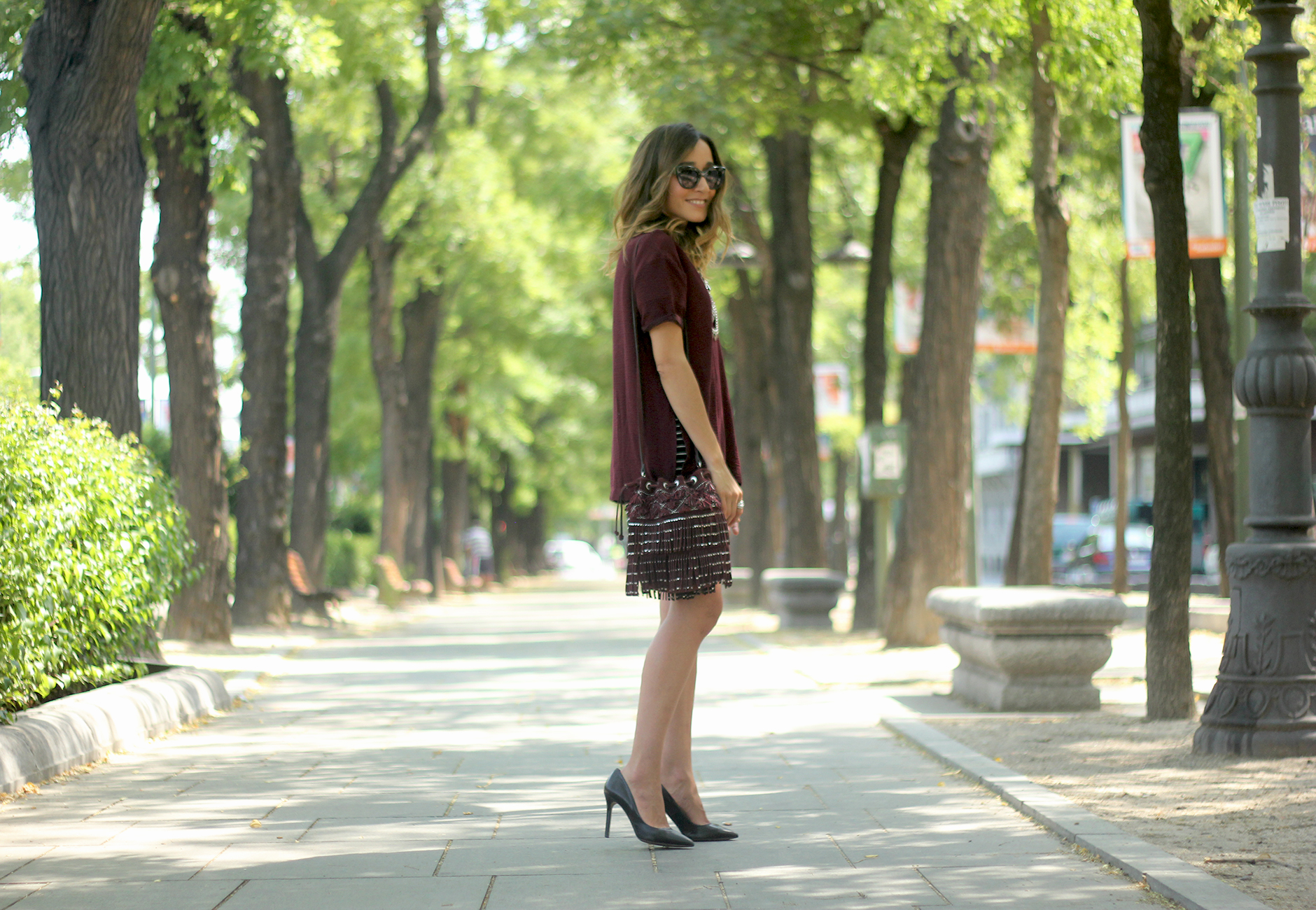 Striped Skirt With Burgundy T-shirt And Fringed Bag Summer Outfit26