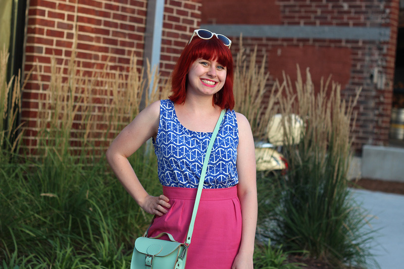 Red Hair, Blue Anchor Print Blouse, Pink Skirt, and Mint Green Satchel Bag