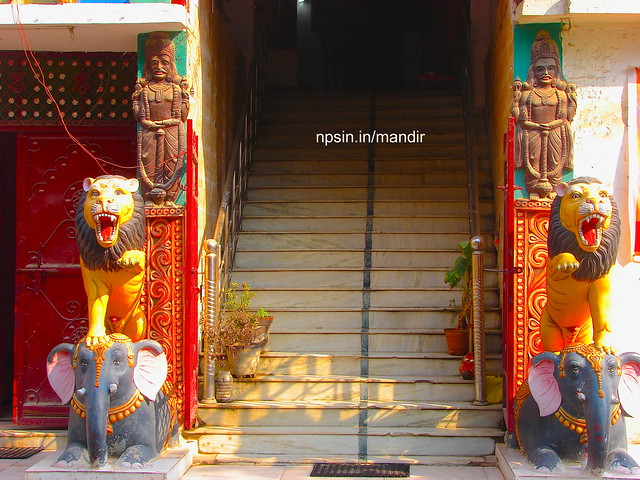 Big Lion and Elephant Statue with Temple Stairs