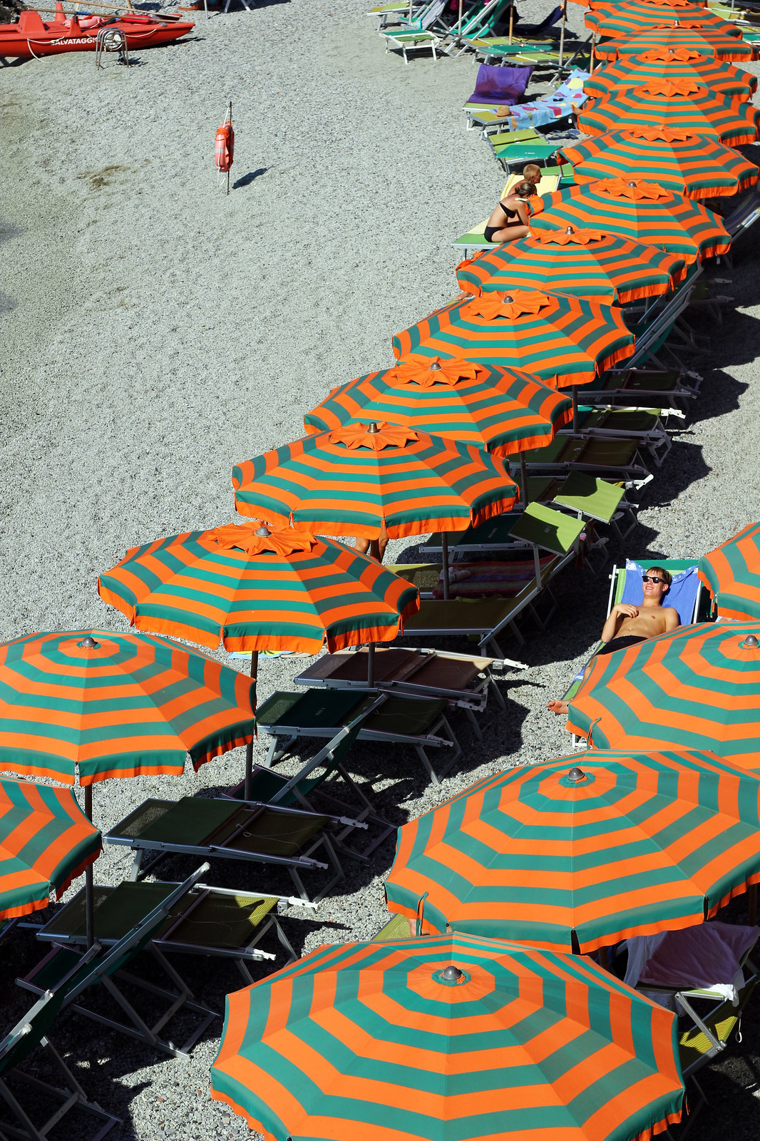 Monterosso Cinque Terre orange striped beach umbrellas