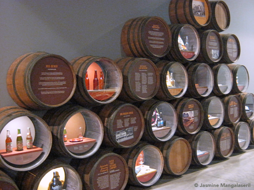 Wall of brewery merchandise in beer casks