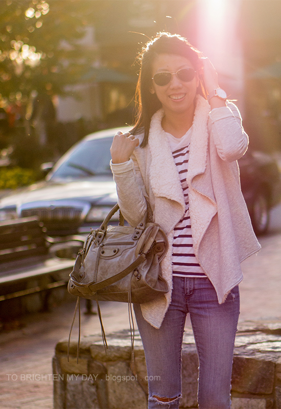 gray sweatshirt cardigan, striped top, jeans, oversized watch