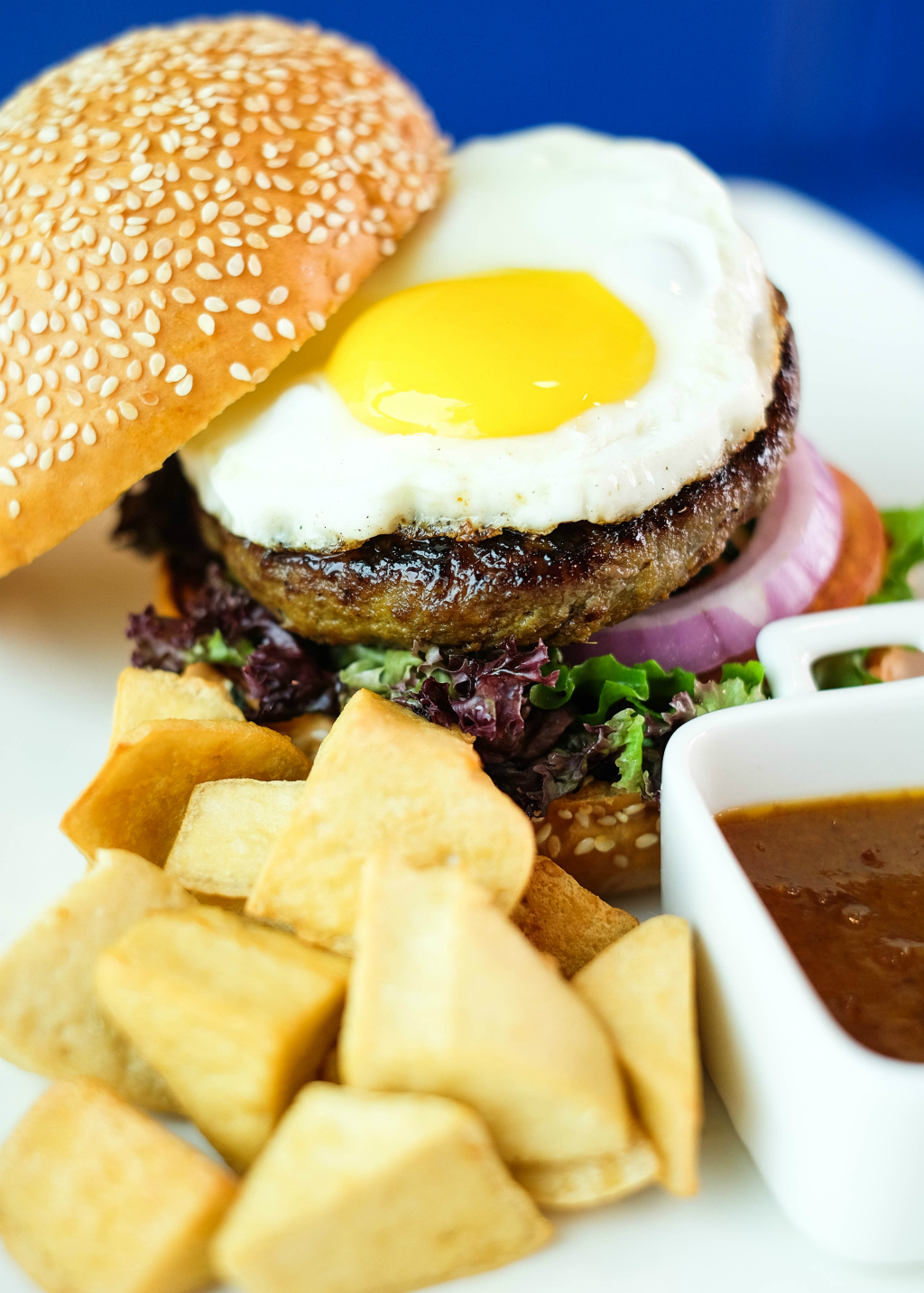 Blue Lagoon Restaurant in Superstar Gemini: satay burger with a patty that is flvoured with peanut sauce with sunny side up
