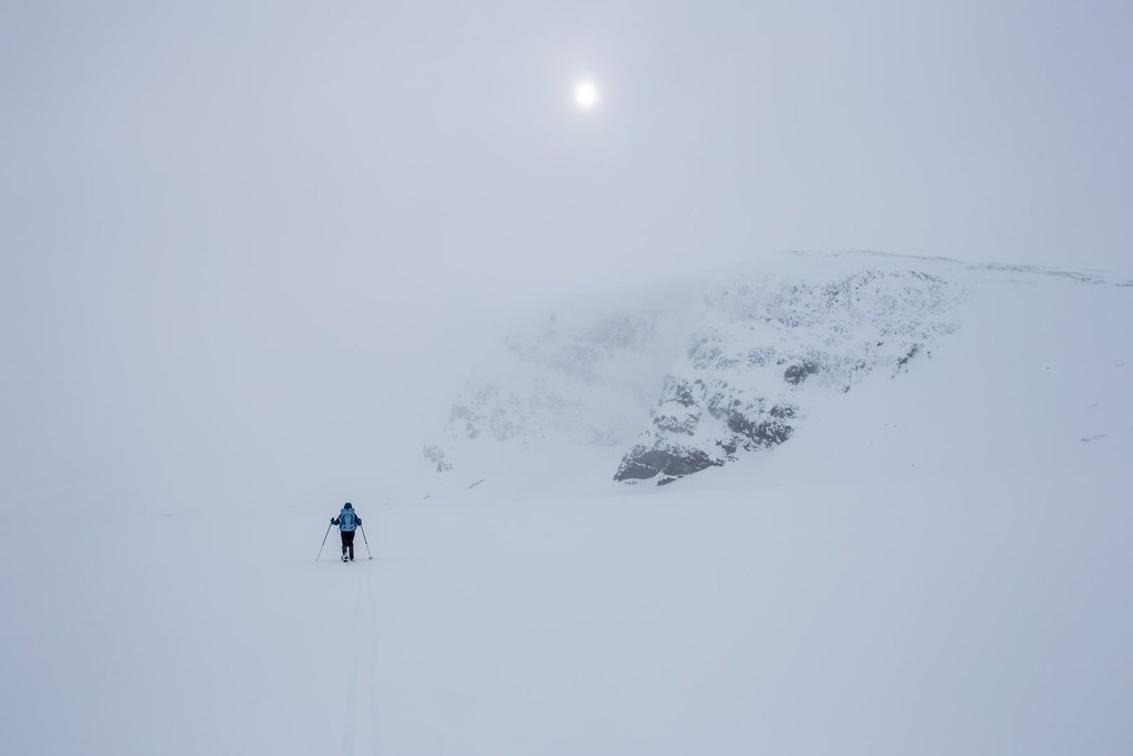 On backcountry skies towards Kebnekaise. A flare of sun through the windy fog. #3monthspregnantinpicture