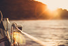 Bright and warm sunset on sailboat by thethomsn