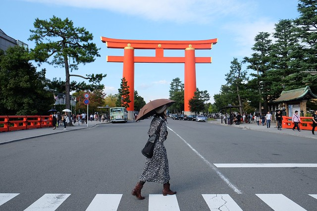 Lady in front of a giant Torii Gate