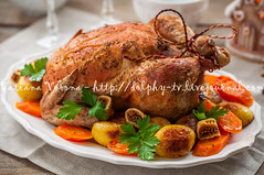 Christmas Stuffed Chicken Served with Potatoes, Ca…