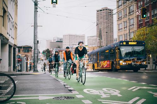 platoon of bikes crossbike bus broadway seattle