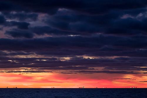 ships sunrise dawn surf bolivarflats galvestoncounty texas seascape clouds gseloff