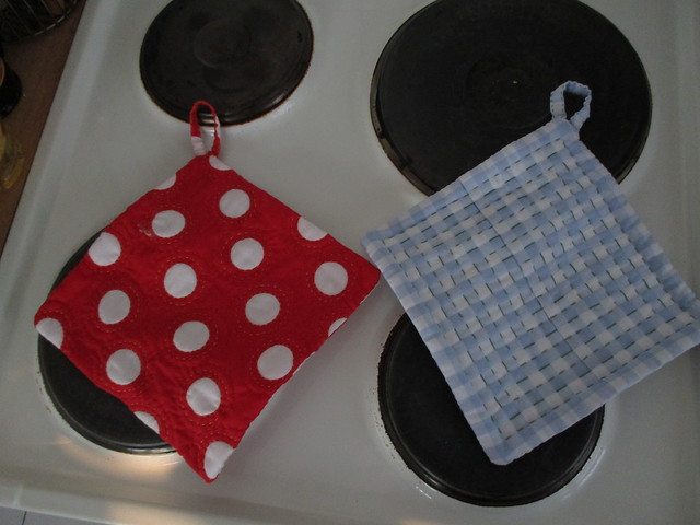 new potholders - yes I'm desperate enough to completely handsew them