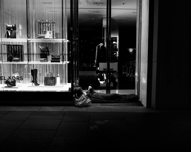 A Homeless Guy Reading A Book - Newcastle